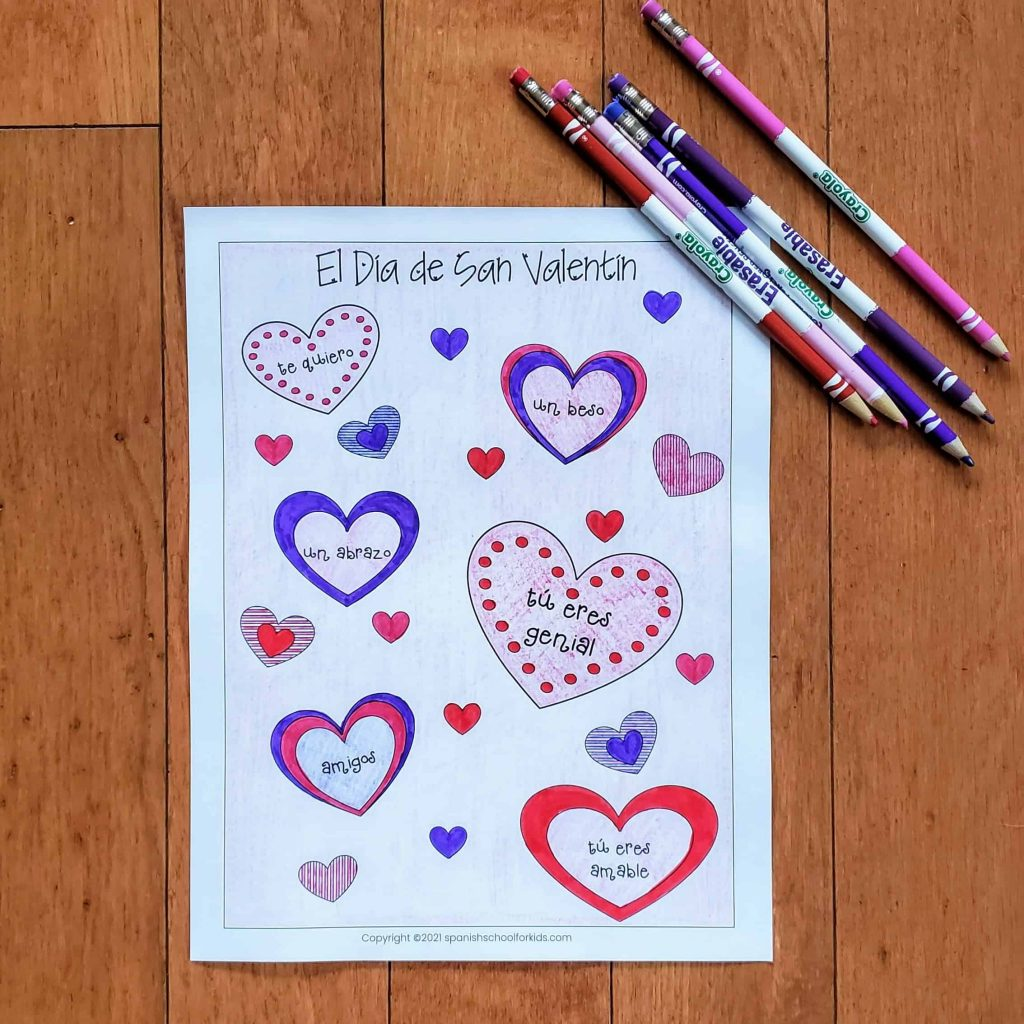 picture of spanish valentine coloring page with hearts and spanish phrases for Valentine's Day
